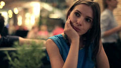 Sad beautiful woman sitting in restaurant HD Stock Footage
