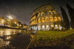 Lights of Colosseum at Night Stock Photos