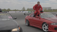 Racer sitting in a sports car Stock Footage