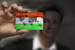 Close up to credit card in man hand, flag of India Stock Photos