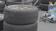 Race car wheel - tire service  Stock Footage