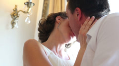 Beautiful happy newly married couple kiss passionately Stock Footage