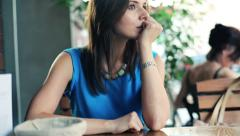 Young impatient woman waiting for someone in cafe HD Stock Footage