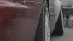 Wheel of race car Stock Footage