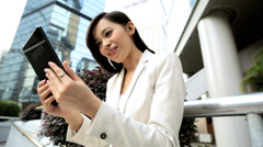 Young Ethnic Asian Chinese Businesswoman City Downtown Mini Tablet Device - stock footage