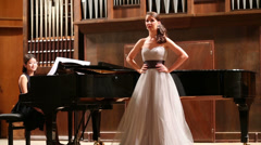 Woman pianist and opera singer have fun before the performance Stock Footage