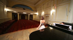 Review from stage with pianist and singer to empty opera hall - stock footage