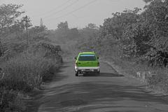 Stock Photo of Car on rural road, India