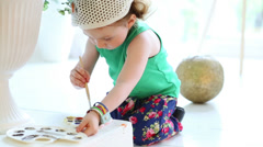 Cute little painter with brush in hand and palette Stock Footage