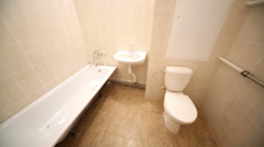 Full bathroom with bath, pedestal washbasin, toilet bowl Stock Footage