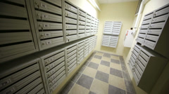 Corridor with letter boxes on walls in new residential building. Stock Footage