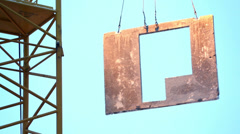 Crane lowers concrete slab to place it must be mounted. Stock Footage