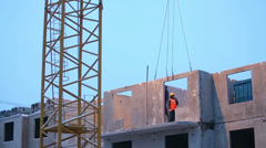 Workers control mounting concrete slab to proper place. Stock Footage