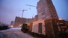 Construction site in winter evening, floodlight lighting. Stock Footage