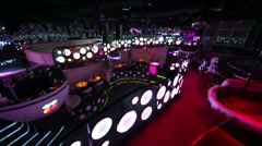 Interior of empty Pacha Moscow night club illuminated Stock Footage