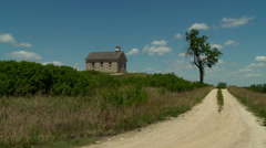 Kansas Flint Hills school house with tree looking north Stock Footage