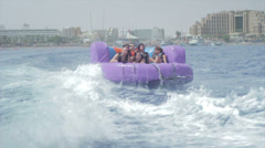 Group of friends enjoying tubing attraction on the water 13 Stock Footage