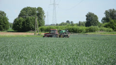 Fertilizing tractor makes turn cereal field continue spray  corn Stock Footage