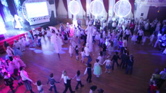 Children move in roundelay at White Ball - holiday for children Stock Footage