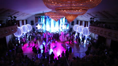 People crowd in front of stage at White Ball holiday for children Stock Footage