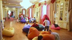 Little children play in lobby of restaurant complex Surikov Hall Stock Footage
