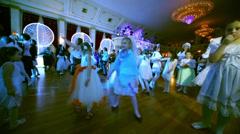 Children dance on dancefloor in front of stage Stock Footage