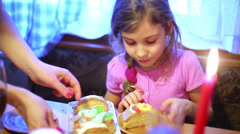 Mother puts piece of cake onto plate and girl gives it to brother Stock Footage