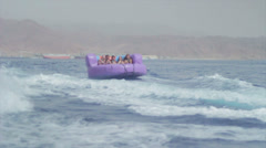 Group of friends enjoying tubing attraction on the water 3 Stock Footage