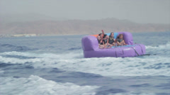Group of friends enjoying tubing attraction on the water 4 Stock Footage