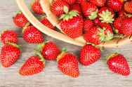 Stock Photo of ripe strawberry in wicker basket