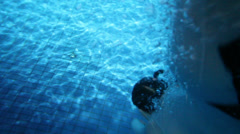 Girl dives into water to bottom and comes to water surface Stock Footage