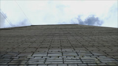 Brick wall a tall house on a background of clouds Stock Footage