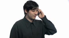 Male talking on phone with serious expression - stock footage