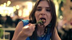 Young happy woman eating salad at the restaurant HD Stock Footage