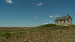 Kansas Flint Hills and old school house pan right Stock Footage