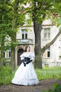 Mysterious woman in a white Victorian dress - stock photo