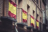 Stock Photo of balconies with spanish flags, spain