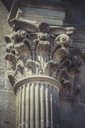 Stock Photo of corinthian capitals, stone columns in old building in spain