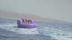 Group of friends enjoying tubing attraction on the water 6 Stock Footage