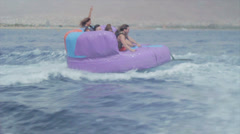 Group of friends enjoying tubing attraction on the water 8 Stock Footage