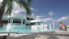 Large Hotel Pool in Jamaica with Palm Tree - stock footage
