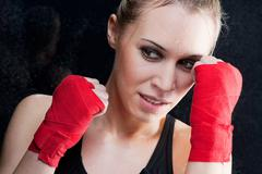 Boxing training blond woman sparring - stock photo