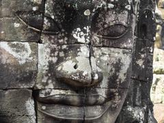 Giant Stone Face at Bayon Temple at Angkor, Cambodia Stock Photos
