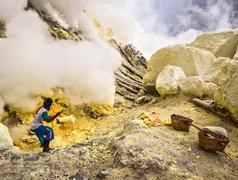 Sulfur Miner Working at Kawah Ijen Volcano in Java, Indonesia Stock Photos
