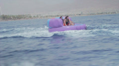 Group of friends enjoying tubing attraction on the water 9 Stock Footage