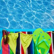 sandals and swimming suit on towel - stock illustration