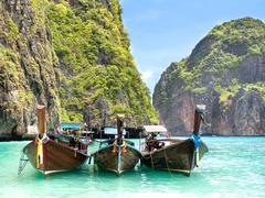 Long Tail Boats in Maya Bay, Ko Phi Phi, Thailand - stock photo
