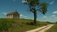 School house and tree in the Flint Hills of Kansas Stock Footage