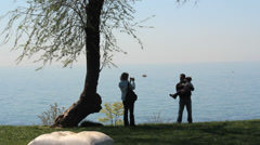 Dad, Mom And Son Taking Photograph At Coast. Stock Footage