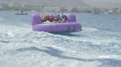 Group of friends enjoying tubing attraction Stock Footage
